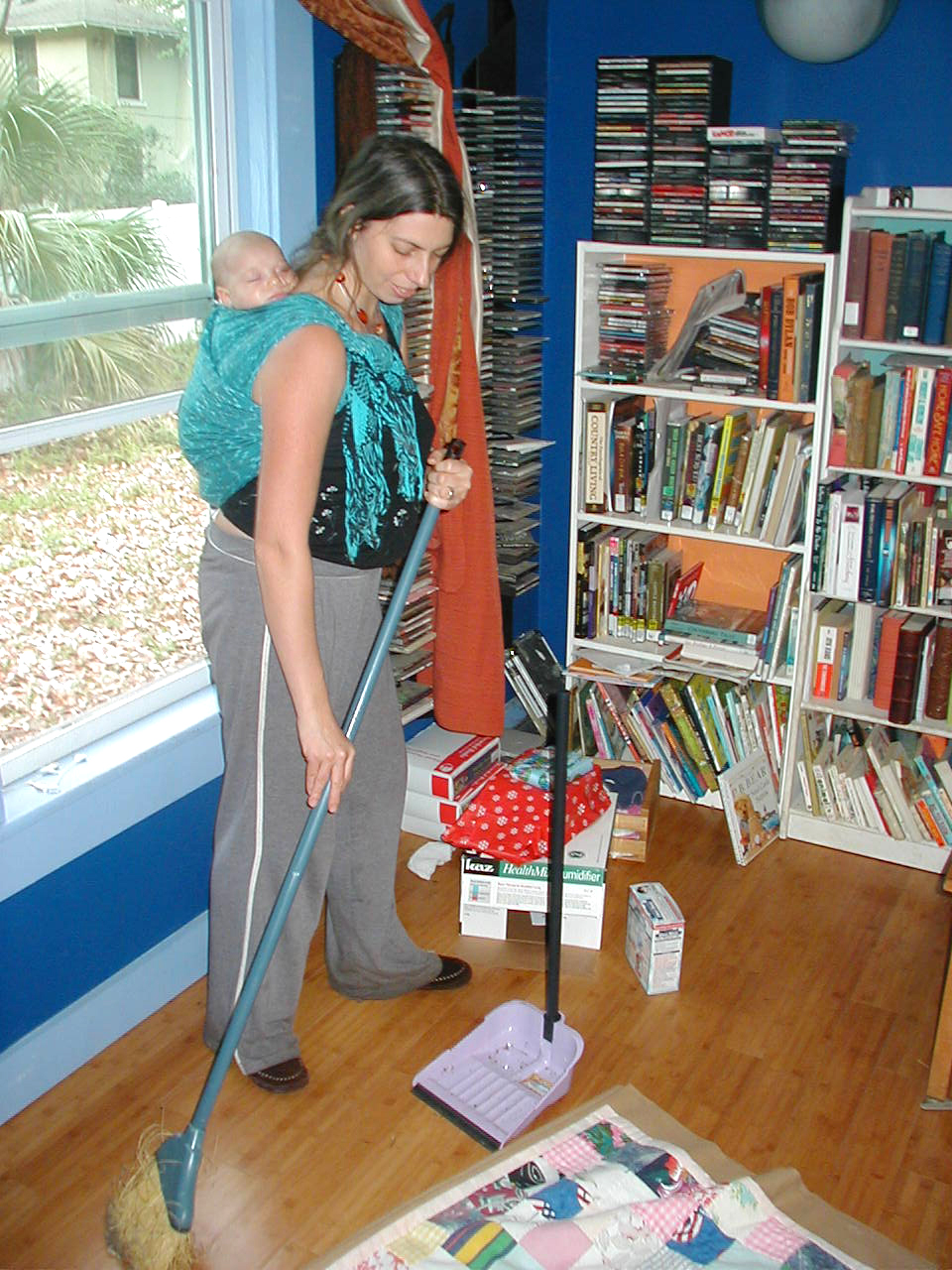 Sweeping while Belle snoozes in a Reinforved Rear Rebozo Rucksack.