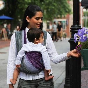 Mom wearing baby downtown in Wrapsody Lily