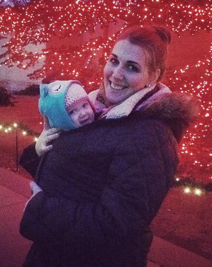 Mom's winter coat around baby in baby carrier