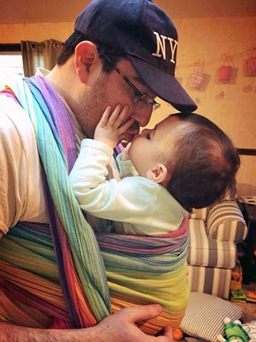 Dad keeping baby close enough to kiss in FWCC