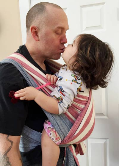 Babywearing Dad with baby close enough to kiss