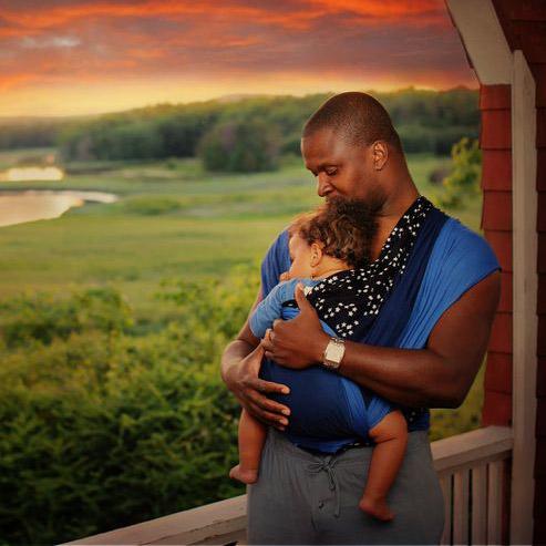 Dad wearing baby in Wrapsody Stella Wrap