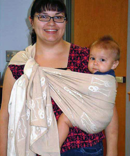 Sarah weighs about 200 lbs and uses a size 2 woven wrap to carry baby in a Traditional Sling Carry on her hip.