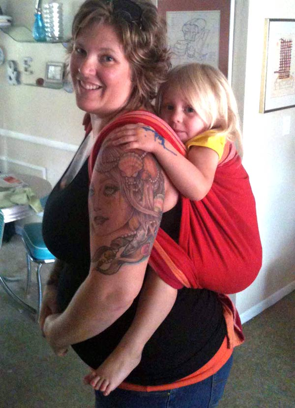 Plus size mom using a size 2 woven wrap to carry toddler in a back carry