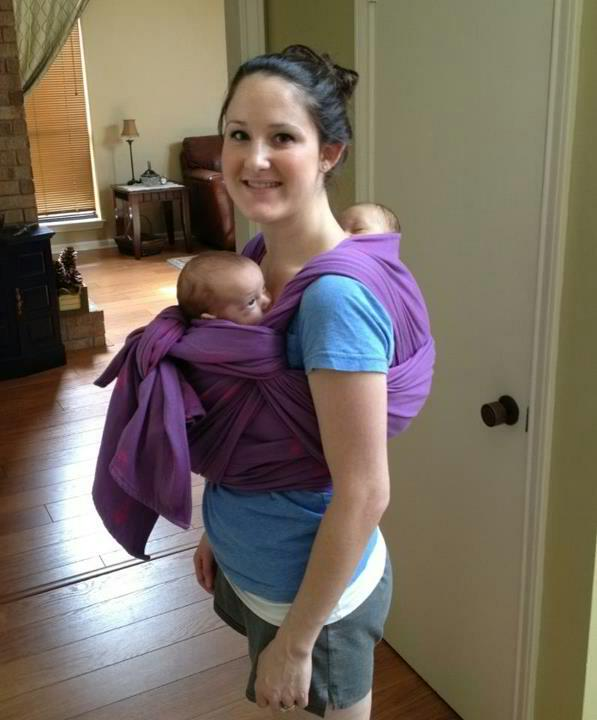 Tandem Babywearing with twins - one in front and one on the back in one long woven wrap.